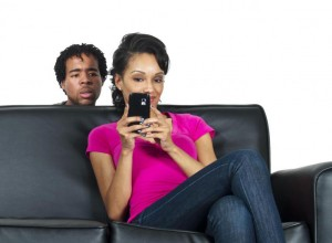 man-spying-on-girlfriends-phone