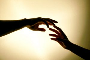 hands-touching-reaching-out