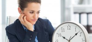 woman looking at clock waiting