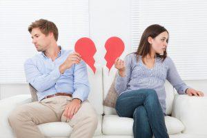 couple tears a red heart